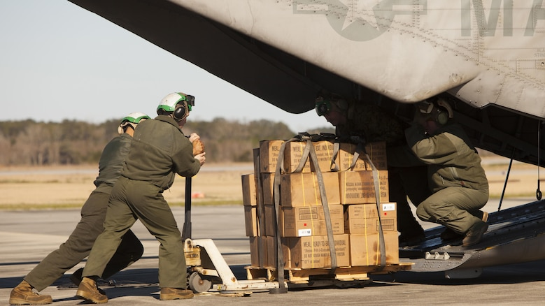 Marines with Marine Heavy Helicopter Squadron 366 load a CH-53E Super Stallion with meals, ready-to-eat during Exercise Eager Response at Marine Corps Air Station Beaufort, S.C., Feb. 25, 2016. Marines trained in events such as casualty evacuation, assault support missions and aerial refueling, proving the Marine Air-Ground Task Force is a highly effective combat force.