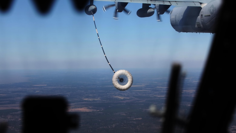 A CH-53E Super Stallion approaches a KC-130J Super Hercules refueling hose during  aerial refueling at Exercise Eager Response at Marine Corps Air Station Beaufort, S.C., Feb. 25, 2016. During the exercise, Marines trained in events such as casualty evacuation, assault support missions and aerial refueling, proving the Marine Air-Ground Task Force is a highly effective combat force.