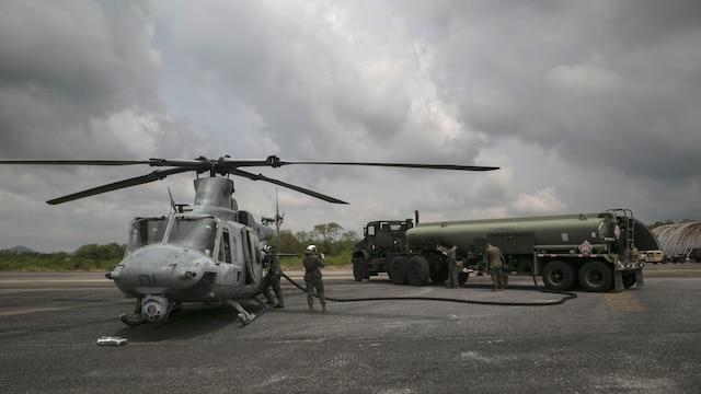 Marines work diligently to refuel a UH-1Y Huey before a flight mission during Cobra Gold 16 in Utapao, Thailand, Feb. 16, 2016. Cobra Gold is a multi-national exercise with aims to increase well-being and relationships between participating nations in the Asia-Pacific. The Marines are with Marine Wing Support Squadron 172, Marine Aircraft Group 36, 1st Marine Aircraft Wing, III Marine Expeditionary Force, and Marine Light Attack Helicopter Squadron 167 currently supporting MAG 36 under the unit deployment program.