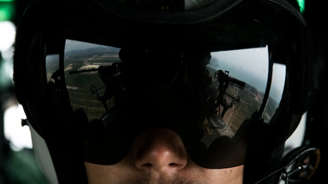 "Lance Cpl. Rommi S. Swelam observes his fellow crew chiefs in a UH-1Y Huey during a flight as part of Cobra Gold 16 in Utapao, Thailand, Feb. 16, 2016. The Huey gives crew chiefs the advantage of having a ""God's eye"" view of the environment below. Cobra Gold is a multi-national exercise designed to increase interoperability and cooperation of participating nations by working toward solutions to common challenges. Swelam, from Raleigh, N.C., is a crew chief with Marine Light Attack Helicopter Squadron 167 which is currently supporting Marine Aircraft Group 36, 1stj Marine Aircraft Wing, III Marine Expeditionary Force under the unit deployment program."