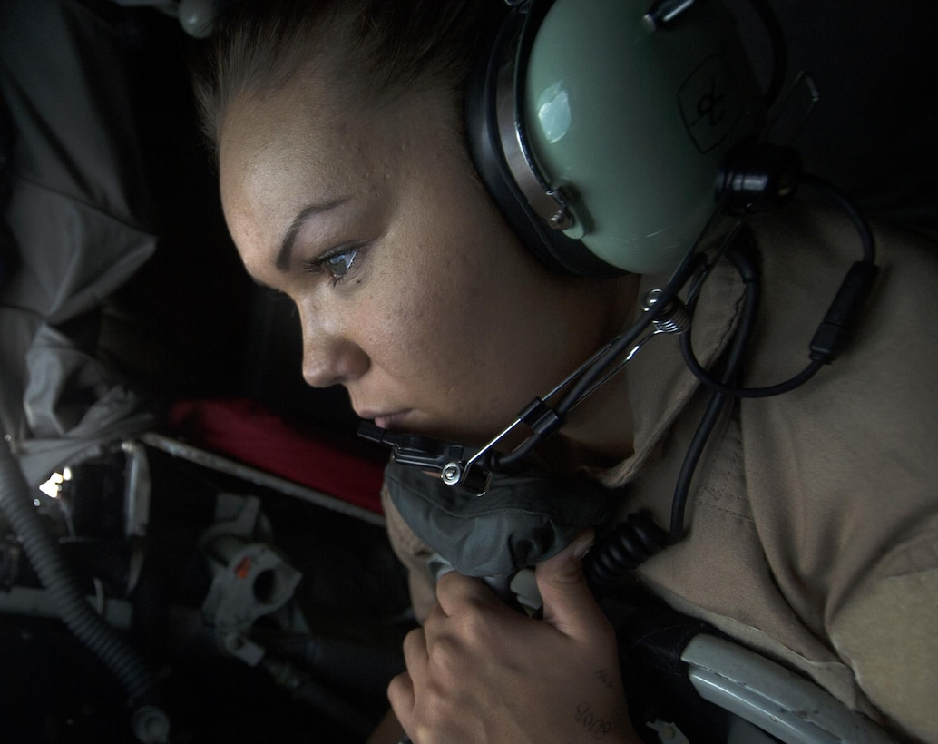 U.S. Air Force Airmen 1st Class Shelby Bowling, 340th Expeditionary Air Refueling Squadron boom operator, refuels a U.S. Marine Corps AV-8B Harrier II over Iraq in support of Operation Inherent Resolve, Dec. 31, 2015.  The 340th EARS reached a significant milestone for 2015 by flying more than 100,000 combat hours before the new year. (U.S. Air Force photo by Tech. Sgt. Nathan Lipscomb)