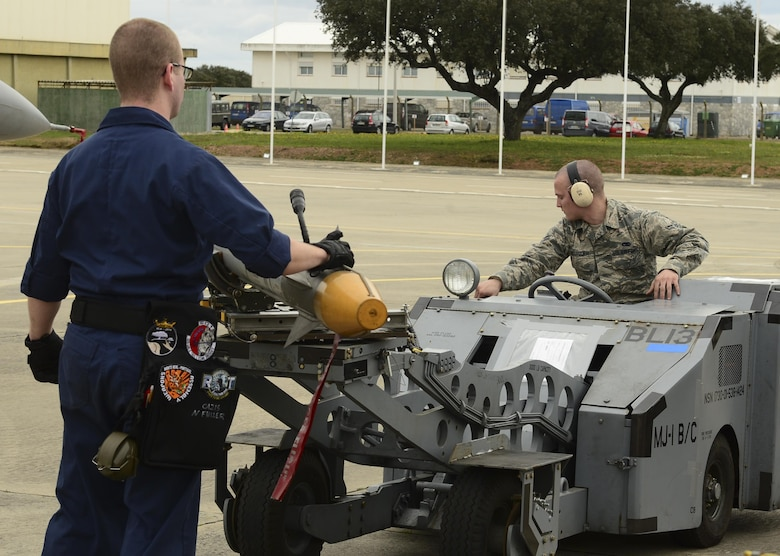 Senior Airman Noah Fuller and Airman 1st Class Edward McGroder, 493rd Aircraft Maintenance Unit weapons load crew members, transport simulated munitions on an MJ-1 Lift Truck during exercise Real Thaw at Beja Air Base, Portugal, Feb. 25, 2016. Real Thaw was designed to provide joint interoperability training throughout the execution of a vast range of battlefield missions, to include day and night operations in a high-intensity joint setting. (U.S. Air Force photo/Senior Airman Dawn M. Weber)