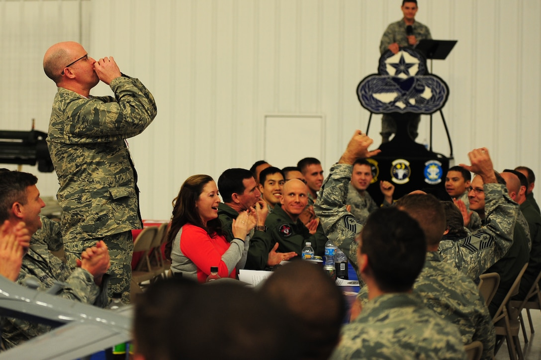 Maintenance leadership calls out to their teammates during a sound-off among the various squadrons in the 27th Special Operations Maintenance Group at the Maintenance Professional of the Year banquet Feb. 26, 2016, at Cannon Air Force Base, N.M. The MPOY banquet is an annual event where all the squadrons within the 27th SOMXG come together to celebrate individual and team achievements. (U.S. Air Force photo/Tech. Sgt. Manuel Martinez)