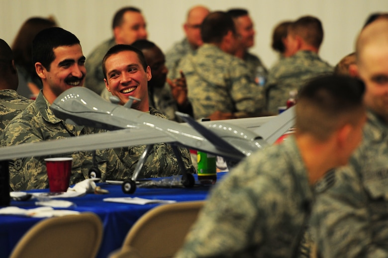 Members of the 27th Special Operations Maintenance Group socialize during the Maintenance Professional of the Year banquet Feb. 26, 2016, at Cannon Air Force Base, N.M. The MPOY banquet is an annual event where all the squadrons within the 27th SOMXG come together to celebrate individual and team achievements. (U.S. Air Force photo/Tech. Sgt. Manuel Martinez)