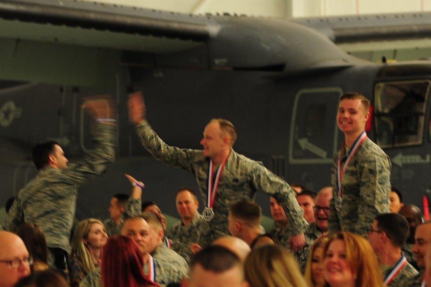 Wingmen celebrate after hearing the winner for a category during the Maintenance Professional of the Year banquet Feb. 26, 2016, at Cannon Air Force Base, N.M. The MPOY banquet is an annual event where all the squadrons within the 27th Special Operations Maintenance Group come together to celebrate individual and team achievements. (U.S. Air Force photo/Tech. Sgt. Manuel Martinez)