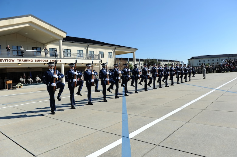 The U.S. Air Force Honor Guard Drill Team performs a new routine on the Levitow Training Support Facility drill pad Feb. 26, 2016, Keesler Air Force Base, Miss. During the past month, the team developed the routine to be used throughout the year. (U.S. Air Force photo by Kemberly Groue)