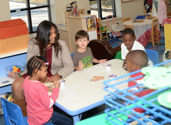 Brianna Foster, Westover High School senior, interacts with children during her job shadowing experience recently at the Children's Development Center aboard the Marine Corps Logistics Base Albany.