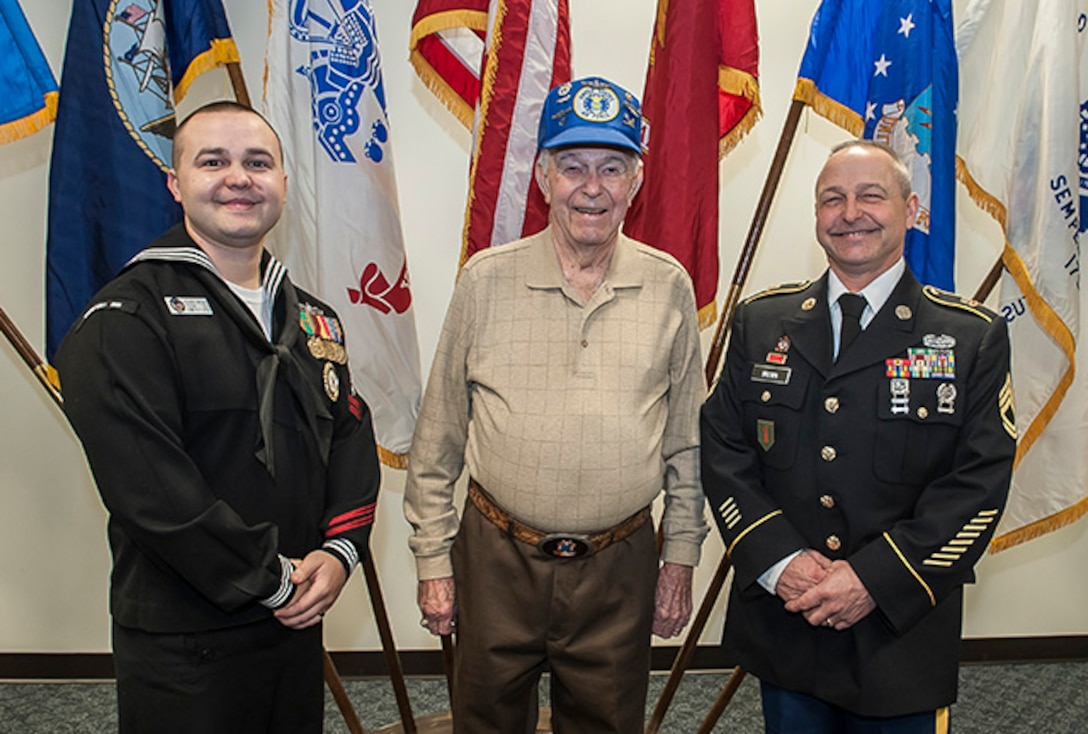 Three generations of veterans with military service totaling nearly 50 years across three branches of service came together on Leap Day to continue the military tradition. Petty Officer 2nd Class Anthony Brown reenlisted for eight more years in the Navy. He's pictured with his grandfather, Karl R. Brown, a 14-year Air Force veteran, who served during the Korean War era, and his father, Karl, who retired from the Army after 26 years and two deployments to Iraq, and now works as a welder at DSCC.