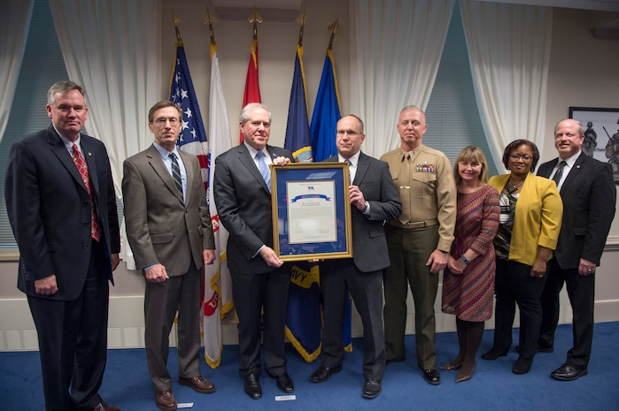 Under Secretary of Defense for Acquisition, Technology and Logistics Frank Kendall presents the David Packard Excellence in Acquisition Award to the Program Executive Officer Land Systems Ground/Air Task Oriental Radar Team during a ceremony at the Pentagon Feb. 19. G/ATOR is a next-generation radar that provides air surveillance/air defense, counter-fire target acquisition, and air traffic control capabilities. (DOD photo by Master Sgt. Adrian Cadiz)