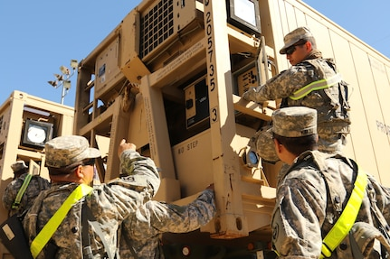 Spc. Robin Trinidad (right), an automated logistics specialist from the 103rd Quartermaster Company in Houston, inspects a cooler Feb. 17, 2016, at Fort Polk, La., used to preserve perishable foods in the field. The Los Angeles native and his Army Reserve company are supporting field exercises during a base field exercise. (U.S. Army photo by Sgt. Brandon Hubbard, 204th PAD)