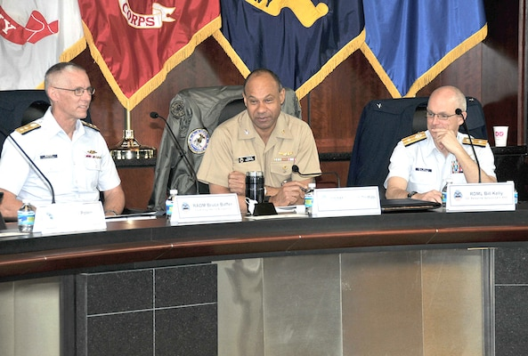 DLA Logistics Operations Director Navy Rear Adm. Vince Griffith (middle) describes the agency's mission to Coast Guard Rear Adm. Bill Kelly, commander of the Coast Guard's Personnel Service Center (left), and Coast Guard Rear Adm. Bruce Baffer, the Coast Guard's assistant commandant for engineering and logistics (right).