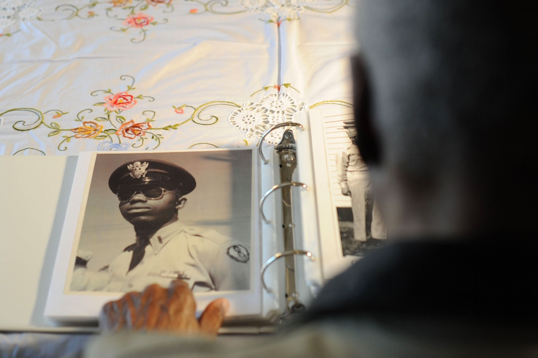 Retired Maj. George Boyd looks at a photo of himself in service dress when he was younger at his home in Wichita, Kan., Feb. 25, 2016. Boyd served for nearly three decades as an enlisted Airman and a commissioned officer and is currently a colonel in the U.S. Civil Air Patrol. (U.S. Air Force photo/Airman 1st Class Christopher Thornbury)