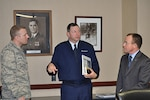 Air Force Brig. Gen. Mark Johnson (center), commander, Oklahoma City Air Logistics Complex, Tinker Air Force Base, Oklahoma speaks with Air Force Capt. Joshua Wilkerson-Bienick and Jeff Allen, Air Force Sustainment Center, executive director.  Johnson urged Wilkerson-Bienick to make the most of his logistics career broadening opportunity while at Defense Logistics Agency Aviation. Johnson and Allen attended briefings with DLA Aviation senior leaders Feb. 23, 2016 on Defense Supply Center Richmond, Virginia.