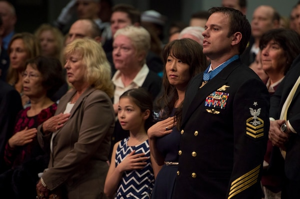 Navy Senior Chief Petty Officer Edward C. Byers Jr., a Medal of Honor recipient, stands with his family during a ceremony to induct him into the Hall of Heroes at the Pentagon March 1, 2016. DoD photo by Air Force Senior Master Sgt. Adrian Cadiz