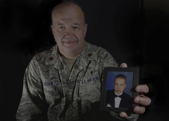 U.S. Air Force Maj. William Logan, a chaplain with the 35th Fighter Wing, holds a picture of his son, Zac, at Misawa Air Base, Japan, Feb. 23, 2016. Logan shared the story of his son's suicide and the effects of the aftermath. He highlighted the recovery process hoping to inspire others to come forward for help in times of need. Logan is from Medina, Tennessee. (U.S. Air Force photo by Airman 1st Class Jordyn Fetter/Released)