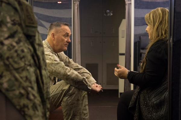 Marine Corps Gen. Joseph F. Dunford Jr., chairman of the Joint Chiefs of Staff, talks with Jane Horton, a Gold Star wife, en route to Kabul, Afghanistan, March 1, 2016. Dunford is visiting Afghanistan to meet with senior military and civilian leaders, and attend the Resolute Support and U.S. Forces Afghanistan change-of-command ceremony. DoD photo by D. Myles Cullen