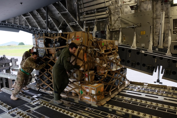 U.S. Army Reservists load pallets onto a C-17 from Joint Base Charleston, South Carolina during a joint partnered movement control  mission with French Air Force members Feb. 22, 2016. This mission is  in support of United States Africa Command's Operation Echo Casemate resupply mission to French military forces deployed to the Central African Republic.  (Photo by Sgt. 1st Class Matthew Chlosta)