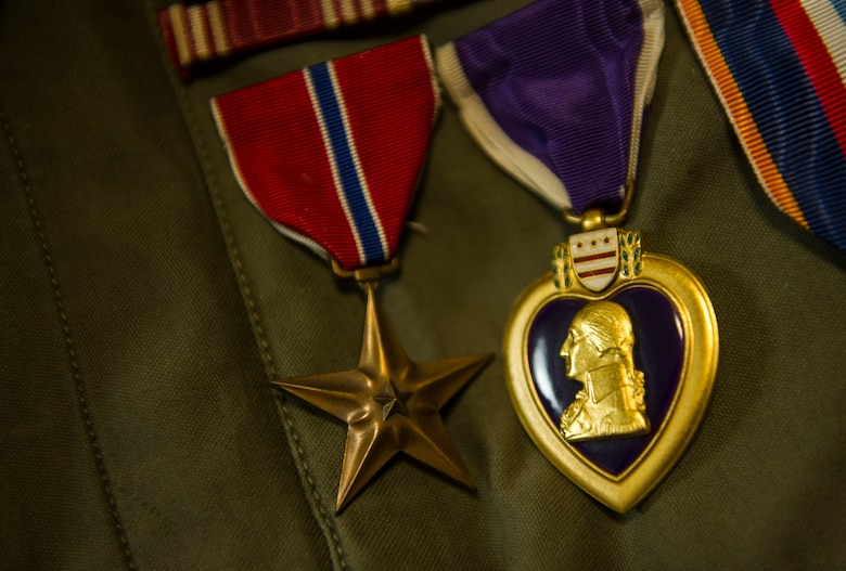 The Bronze Star and Purple Heart medals hang from U.S. Army Private 1st Class (Sep.) Lynn Aas' jacket during an interview at the Dakota Territory Air Museum in Minot, N.D., Feb. 18, 2016. Aas was awarded these prestigious medals for the sacrifices he made during his time as a combat infantryman during the Battle of the Bulge. (U.S. Air Force photo/Senior Airman Apryl Hall)