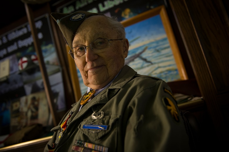 U.S. Army Private 1st Class (Sep.) Lynn Aas, 17th Airborne Division combat infantry rifleman, poses for a photo at the Dakota Territory Air Museum in Minot, N.D., Feb. 18, 2016. Aas served during the Battle of the Bulge and was awarded the Bronze Star and Purple Heart for his sacrifices. (U.S. Air Force photo/Senior Airman Apryl Hall)