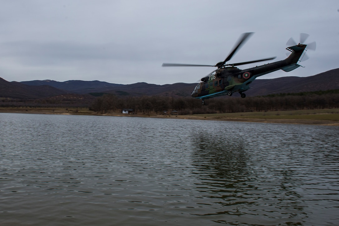 PLOVDIV, Bulgaria - A Bulgarian Cougar military helicopter flies over a body of water during combat search and rescue training near Plovdiv, Bulgaria, Feb. 11, 2016. The helicopter was protected by 74th Expeditionary Fighter Squadron A-10C Thunderbolt II aircraft during the training. (U.S. Air Force photo by Airman 1st Class Luke Kitterman/Released)