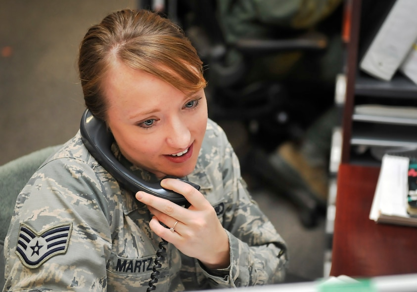 Staff Sgt. Joy Martz, 603rd Air and Space Operations Center Air Mobility Division NCO in charge of training, makes a phone call Feb. 19, 2016, at Ramstein Air Base, Germany. Martz is from Fort Collins, Colorado and joined the Air Force in 2010. She has been stationed at Cannon Air Force Base, New Mexico, Incirlik Air Base, Turkey and now Ramstein Air Base, Germany. (U.S. Air Force photo/Airman 1st Class Larissa Greatwood)
