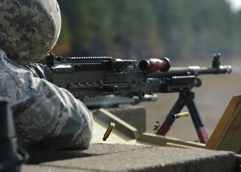 U.S. Air Force Staff Sgt. Ryan Quade, a 19th Security Forces Squadron combat arms instructor, fires an M240B machine gun Feb. 24, 2016, at Camp Joseph T. Robinson, Ark. Team Little Rock combat arms instructors routinely utilize nearby Army posts to qualify on a variety of weapons. (U.S. Air Force photo/ Senior Airman Harry Brexel)