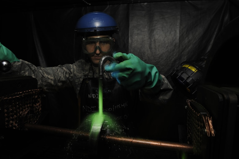 Staff Sgt. John Stevens, 8th Maintenance Squadron non-destructive inspection shift supervisor, uses ultraviolet lights to inspect aircraft parts March 2, 2016, at Kunsan Air Base, Republic of Korea. The 8th MXS NDI shop inspects metal objects ranging from nuts and bolts, to large hooks and sheets of metal to ensure the safety of the aicraft. (U.S. Air Force photo/Senior Airman Dustin King)