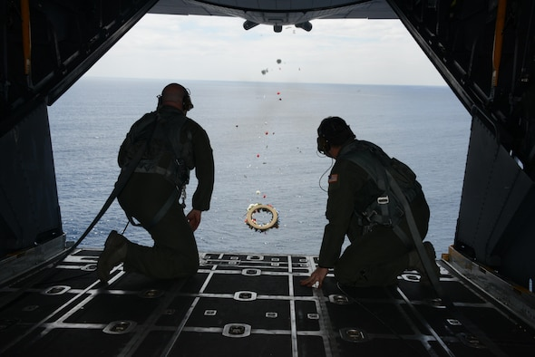 From left, Tech. Sgt. Brett Bollinger and Tech. Sgt. Michael Gillette, both loadmasters at the 1st Special Operations Squadron drop a wreath from a U.S. Air Force MC-130H Combat Talon II off the coast of the Philippines Feb. 26, 2016 in memory of those who died in the crash of Stray 59.  The flight honors those who were lost 35 years ago when a 1st SOS MC-130E, call sign STRAY 59, crashed during an exercise killing eight crew members and 15 passengers. (U.S. Air Force photo by Master Sgt. Kristine Dreyer, 353rd Special Operations Group Public Affairs)