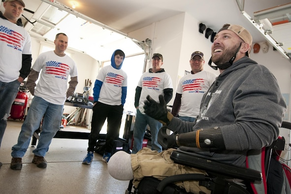U.S. Army Sgt. (ret.) Adam Keys expresses his gratitude to a group of 459th Aircraft Maintenance Squadron members at his home in Annapolis, Md., Feb. 27, 2016. Ten members of the 459 AMXS volunteered on behalf of the nonprofit Patriots Honor to unpack, build and install workbenches, power tools and roll-aways in Keys' garage in effort to help make dreams come true for Wounded Warriors. Keys, a triple amputee who has endured more than 130 surgeries due to injuries sustained from an IED explosion in Afghanistan in 2010, intends to use the equipment to pursue his hobby of building small engines and model cars. (U.S. Air Force photo by Staff Sgt. Kat Justen)