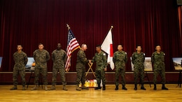 U.S. Marine Corps Col. Clay Tipton, commanding officer, 11th Marine Expeditionary Unit, shakes hands with Col. Yoskiyuki Goto, commanding officer, Western Army Infantry Regiment, Japan Ground Self-Defense Force, after recognizing select Marines and JGSDF soldiers for their outstanding  performance during Exercise Iron Fist 2016, at the exercise's closing ceremony at Marine Corps Base Camp Pendleton, California, March 1, 2016. Exercise Iron Fist is an annual exercise conducted between the USMC and JGSDF, designed to improve their ability to conduct amphibious operations. The ceremony brought together both militaries in celebration and formally concluded the 11th iteration of Exercise Iron Fist.