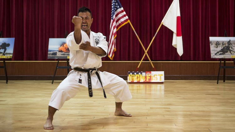 A soldier with Japan Ground Self-Defense Force offers a Karate demonstration for U.S. Marines and other JGSDF soldiers at Marine Corps Base Camp Pendleton, California, March 1, 2016, during the closing ceremony of Exercise Iron Fist 2016. Iron Fist also allows for Marines to train with warriors from a different culture, building camaraderie between the USMC and JGSDF.