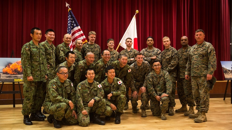 U.S. Marines and Japan Ground Self-Defense Force soldiers pose for a group photograph at Marine Corps Base Camp Pendleton, California, March 1, 2016, after the closing ceremony of Exercise Iron Fist 2016. The ceremony concluded the 11th iteration of Exercise Iron Fist, an annual, bilateral amphibious training exercise designed to improve the USMC and JGSDF ability to plan, communicate and conduct combined amphibious operations.