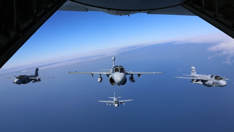 """Four EA-6B Prowlers belonging to each Prowler squadron aboard Marine Corps Air Station Cherry Point conducted a """"Final Four"""" division flight aboard the air station March 1, 2016. The """"Final Four"""" flight is the last time the Prowler squadrons will be flying together before the official retirement of Marine Tactical Electronic Warfare Training Squadron 1 at the end of Fiscal Year 16 and the eventual transition to """"MAGTF EW"""". MAGTF EW is a more distributed strategy where every platform contributes to the EW mission, enabling relevant tactical information to move throughout the electromagnetic spectrum and across the battlefield faster than ever before."""