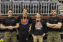 From left to right, Sgt. Justin Bueno, a recruiter with Recruiting Station Denver, River Schroeder, a Burns High School student, Ryder Jones, a Cheyenne Central High School student, and Staff Sgt. Jeffrey Dugan, a recruiter with RS Denver, pose together after the Wyoming State High School Wrestling Tournament, at the Casper Event Center in Casper, WY, Feb. 26 – 27, 2016. Schroeder placed second overall in his weight class of 195 lbs., and Jones placed second overall in his weight class of 126 lbs. The high school students, who are standing next to their respective recruiters, leave for recruit training in August this year.