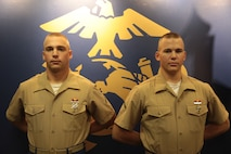 (Left) Pfc. Brandon Willibey, an aviation ordnance technician student and this brother Pfc. Justin Willibey, a military policeman student, Springville, N.Y., natives graduated from Recruit Training with Platoon 1077, Bravo Company, 1st Recruit Training Battalion, Sept. 18, 2015. Their boot camp photos rest on a Transformation Board in Marine Corps Recruiting Substation West Seneca's office, serving as a reminder to all, that becoming a Marine changes the mind, body and spirit. (Official U.S. Marine Corps photo by Staff Sgt. Christopher O'Quin/Released)