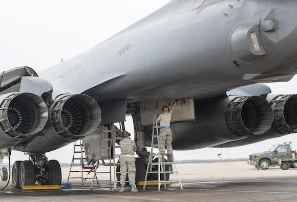 Airmen assigned to the 7th Maintenance Group prep a B-1B Lancer's bomb bay for a Joint Air-to-Surface Standoff Missile Feb. 21, 2016, at Dyess Air Force Base, Texas, during a B-1 Combat Mission Effectiveness Exercise. The exercise challenged Airmen assigned to the 7th Bomb Wing to prepare six B-1s to launch with weapons and deploy the aircraft and personnel within 48 hours. (U.S. Air Force photo by Airman 1st Class Austin Mayfield/Released)