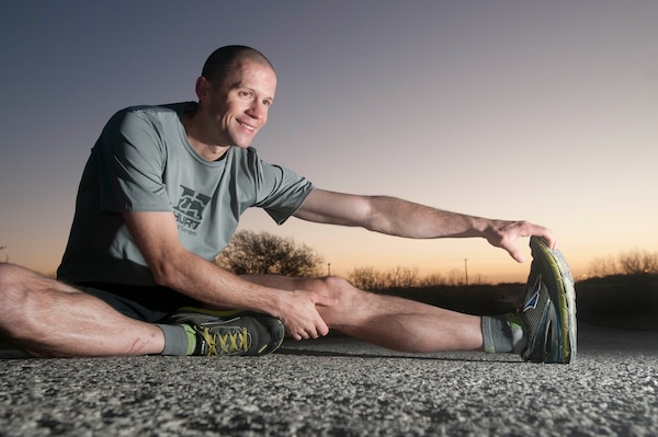 Army Sgt. Douglas Long, a Colorado Springs, Colo., native and a radio and communications security repairer for Company J, 1st Battalion, 12th Cavalry Regiment, 3rd Armored Brigade Combat Team, 1st Cavalry Division, performs some stretches at Fort Hood, Texas, Feb. 2, 2016. Long enjoys running marathons and 100-mile races. Army photo by Sgt. Brandon Banzhaf