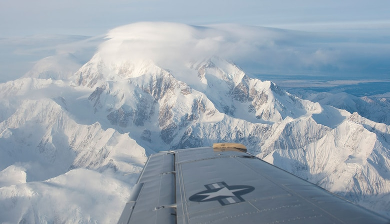 A C-12F Huron flies near Denali during a C-12 site pilot training mission visiting two remote locations in Alaska, Feb. 23, 2016. The pilots have to complete training which includes about 30 hours of flying, landing, training, and instructor-supervised landing at each of the seven remote long-range radar sites. The Huron is assigned to the 517th Airlift Squadron at Joint Base Elmendorf-Richardson, Alaska. (U.S. Air Force photo/Staff Sgt. Sheila deVera)
