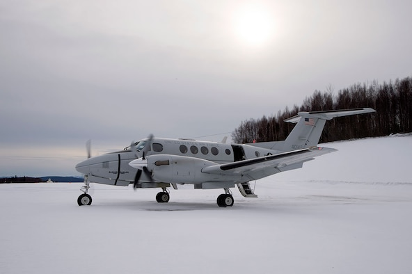 A C-12F Huron assigned to the 517th Airlift Squadron at Joint Base Elmendorf-Richardson, Alaska, waits for passengers to arrive before taking off at Tatalina Air Force Station near McGrath, Alaska, Feb. 23, 2016. Tatalina is a long-range radar site and remains active as part of the Alaska North American Aerospace Defense Command Region. (U.S. Air Force photo/Staff Sgt. Sheila deVera)