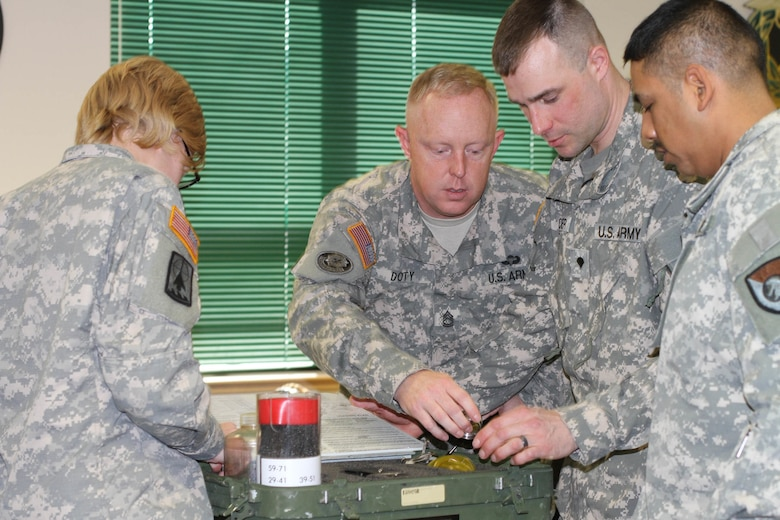 Students of the 94th Training Division's Petroleum Supply Specialist Reclassification Course at Fort Lee, Va., work as a team organizing and inventorying a test kit before moving from the classroom to the field to begin fuel testing as they learn the fundamentals of being a fueler.