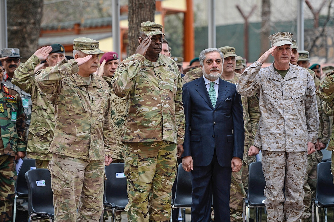 """Marine Corps Gen. Joseph F. Dunford Jr., right, chairman of the Joint Chiefs of Staff; Army Gen. John F. Campbell, left, outgoing commander of U.S. Forces Afghanistan and the NATO Resolute Support Mission; and Army Gen. Lloyd J. Austin III, commander of U.S. Central Command, salute and stand with Afghan Chief Executive Officer Abdullah Abdullah during the change-of-command ceremony on Camp Resolute Support in Kabul, Afghanistan, March 2, 2016. During the ceremony, Army Gen. John W. """"Mick"""" Nicholson Jr. assumed the command. Air Force photo by Staff Sgt. Tony Coronado"""