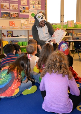 Raúl Alonso, U.S. Army Engineering and Support Center Huntsville Energy Division program manager, dressed as a lemur to read to Mill Creek Elementary School kindergarten students during National Education Association's Read Across America Day, March 2.