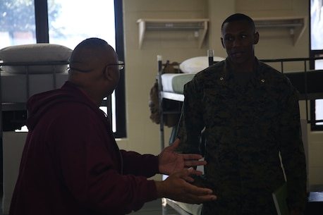 Maj. Kendrick Gaines, commanding officer of Recruiting Station Atlanta, speaks with Martin Orr, an educator from Buford High School, in the Bravo Company barracks aboard Marine Corps Recruit Depot Parris Island, S.C., Mar. 2, 2016. The three-day workshop will give educators a chance to experience the day to day routines aboard the depot and Marine Corps Air Station Beaufort. The purpose of the workshop is to give educators a better understanding of the Marine Corps and reinforce the idea of the Marine Corps as a viable career option. (U.S. Marine Corps photo by Cpl. John-Paul Imbody)