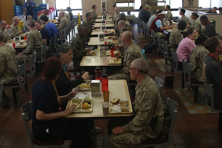 Educators from the greater Atlanta and Columbia areas prepare to each chow with recruits at the Weapons Battalion chow hall Marine Corps Recruit Depot Parris Island, S.C., Mar. 2, 2016. The three-day workshop will give educators a chance to experience the day to day routines aboard the depot and Marine Corps Air Station Beaufort. The purpose of the workshop is to give educators a better understanding of the Marine Corps and reinforce the idea of the Marine Corps as a viable career option. (U.S. Marine Corps photo by Cpl. John-Paul Imbody)