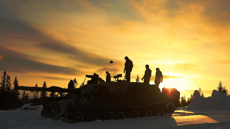 Norwegian Leopard tank crews from the Telemark Battalion prepare for a live-fire exercise in Rena, Norway, Feb. 18, 2016. The U.S. Marines and Norwegians are preparing for Exercise Cold Response 16, which will bring together 12 NATO Allied and partner nations and approximately 16,000 troops in order to enhance joint crisis response capabilities in cold weather environments. The Norwegian Telemark Battalion instructed various U.S. Marine units on cold weather survival techniques to driving armored vehicles on ice-covered roads in the weeks leading up to exercise Cold Response 16 beginning at the end of the month.  The two nations along with the other participating countries will conduct multi-lateral training to improve U.S. Marine Corps capability to operate in cold-weather environments.