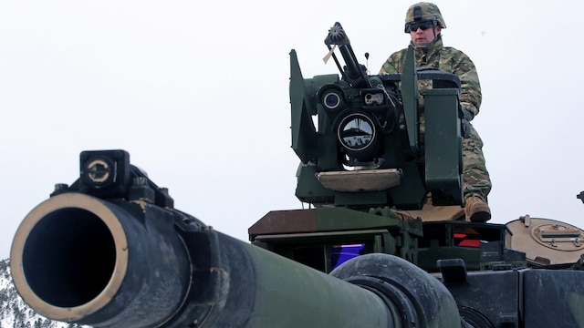 A U.S. Army soldier presents the capabilities of an M1A2 tank on display in Namsos, Norway, March 1, 2016, during Distinguished Visitor Day as part of Exercise Cold Response 16. Distinguished Visitor Day provided high-ranking personnel from all 13 participating countries an overview of the scope, intent and capabilities achieved through integration of personnel and equipment among NATO allies and partners nations. During Cold Response, more than 15,000 troops will work together, learn from each other and sustain and strengthen partnerships, operational capabilities, and coordination.
