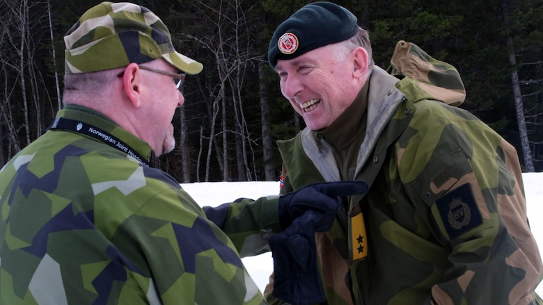 A Norwegian officer (right) and Swedish officer exchange warm welcomes in Namsos, Norway, March 1, 2016, during Distinguished Visitor Day as part of Exercise Cold Response 16. Distinguished Visitor Day provided high-ranking personnel from all 13 participating countries an overview of the scope, intent and capabilities achieved through integration of personnel and equipment among NATO allies and partners nations. During Cold Response, more than 15,000 troops will work together, learn from each other and sustain and strengthen partnerships, operational capabilities, and coordination.