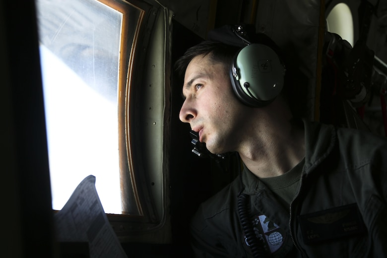 """A crew master observes as four EA-6B Prowlers belonging to each Prowler squadron aboard Marine Corps Air Station Cherry Point conducted a """"Final Four"""" division flight aboard the air station March 1, 2016. The """"Final Four"""" flight is the last time the Prowler squadrons will be flying together before the official retirement of Marine Tactical Electronic Warfare Training Squadron 1 at the end of Fiscal Year 16 and the eventual transition to """"MAGTF EW"""". MAGTF EW is a more distributed strategy where every platform contributes to the EW mission, enabling relevant tactical information to move throughout the electromagnetic spectrum and across the battlefield faster than ever before. (U.S. Marine Corps photo by Cpl. N.W. Huertas/Released)"""