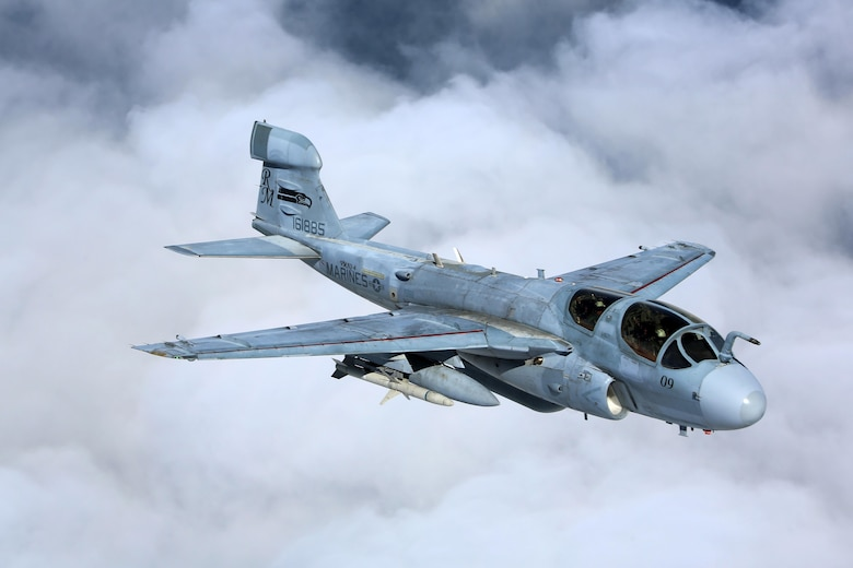 """Four EA-6B Prowlers belonging to each Prowler squadron aboard Marine Corps Air Station Cherry Point conducted a """"Final Four"""" division flight aboard the air station March 1, 2016. The """"Final Four"""" flight is the last time the Prowler squadrons will be flying together before the official retirement of Marine Tactical Electronic Warfare Training Squadron 1 at the end of Fiscal Year 16 and the eventual transition to """"MAGTF EW"""". MAGTF EW is a more distributed strategy where every platform contributes to the EW mission, enabling relevant tactical information to move throughout the electromagnetic spectrum and across the battlefield faster than ever before. (U.S. Marine Corps photo by Cpl. N.W. Huertas/Released)"""