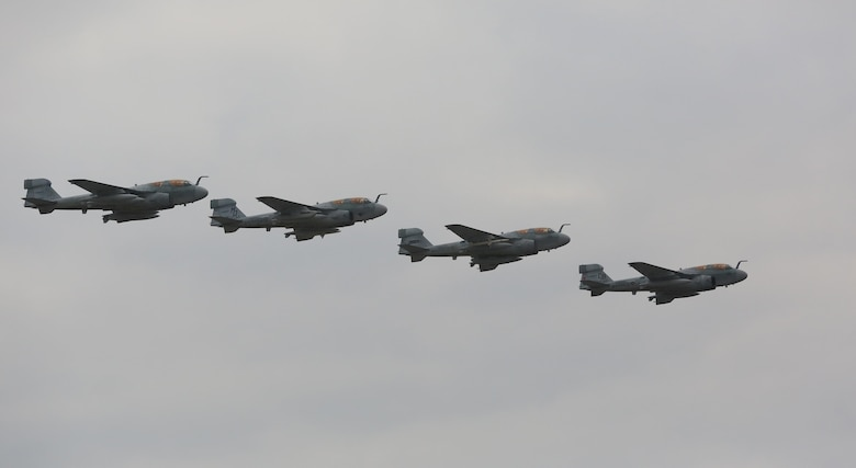 """Four EA-6B Prowlers belonging to each Prowler squadron aboard Marine Corps Air Station Cherry Point conducted a """"Final Four"""" division flight aboard the air station March 1, 2016. The """"Final Four"""" flight is the last time the Prowler squadrons will be flying together before the official retirement of Marine Tactical Electronic Warfare Training Squadron 1 at the end of Fiscal Year 16 and the eventual transition to """"MAGTF EW"""". MAGTF EW is a more distributed strategy where every platform contributes to the EW mission, enabling relevant tactical information to move throughout the electromagnetic spectrum and across the battlefield faster than ever before. (U.S. Marine Corps photo by Lance Cpl. Mackenzie Gibson/Released)"""